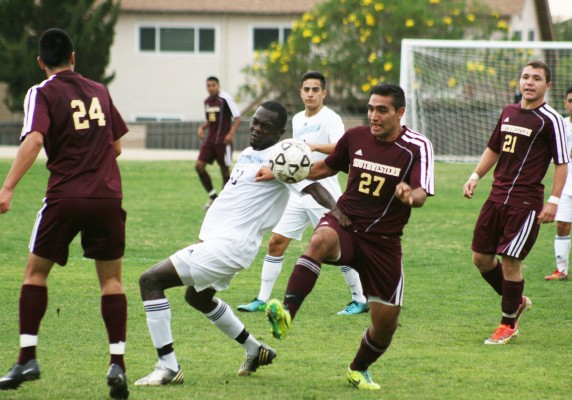 TUSSLE FOR THE TITLE— Freshman forward Walter Parra fights for possession against Cuyamaca. SWC won, 2-1, to clinch the Pacific Coast Athletic Conference title. Photo by John Domogma