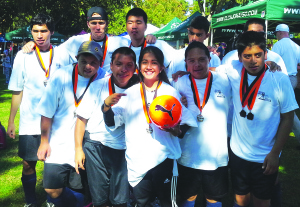 Petite lady is a big cat — Southwestern College architect major Poema Sandoval has won praise and earned the respect of her Chula Vista Pumas soccer team for disabled players.  Serina Duarte/Staff
