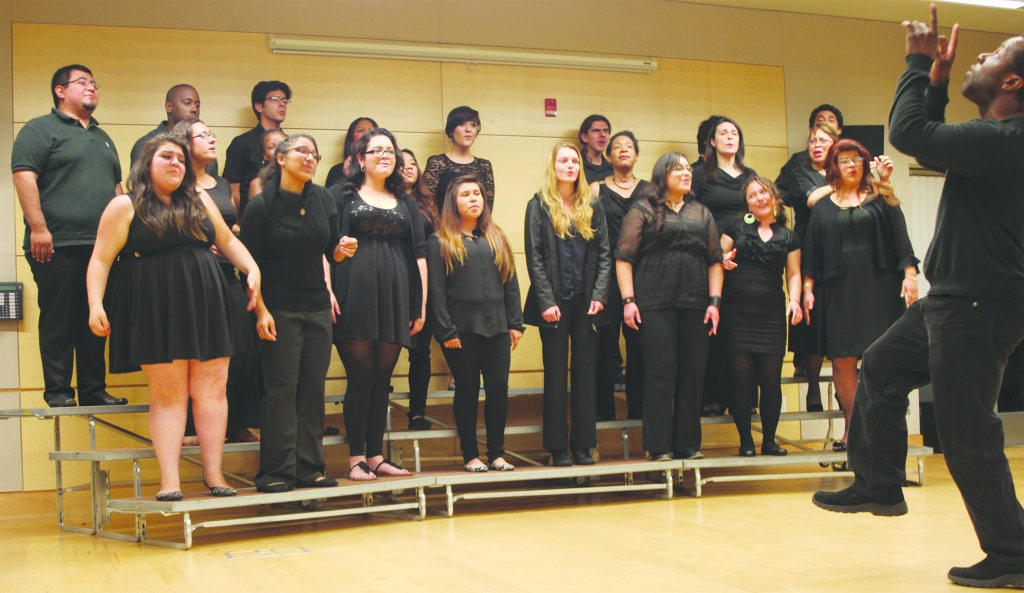 Southwestern College's gospel choir Director Leonard Patton guides students to a successful debut.  Photo by John Domogma