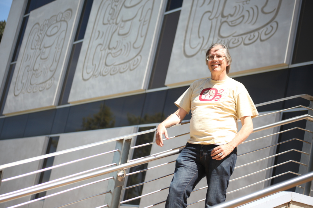 CRACKING THE CODE - Dr. Van Stone designed the Mayan Hieroglyphics that ring the campus library.   Photo by John Domogma.