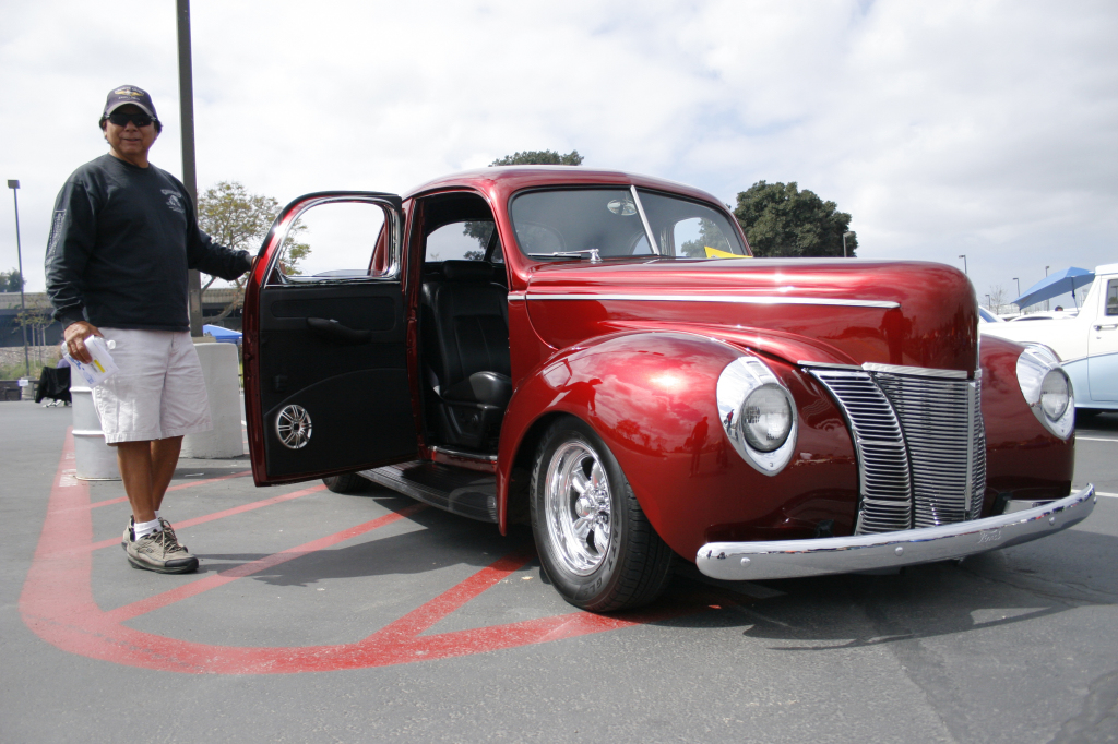 "LIKE FINE WINE—Pete Jimenez's 1940 Ford coupe with its special ""merlot jewel"" red paint job and handleless suicide doors."
