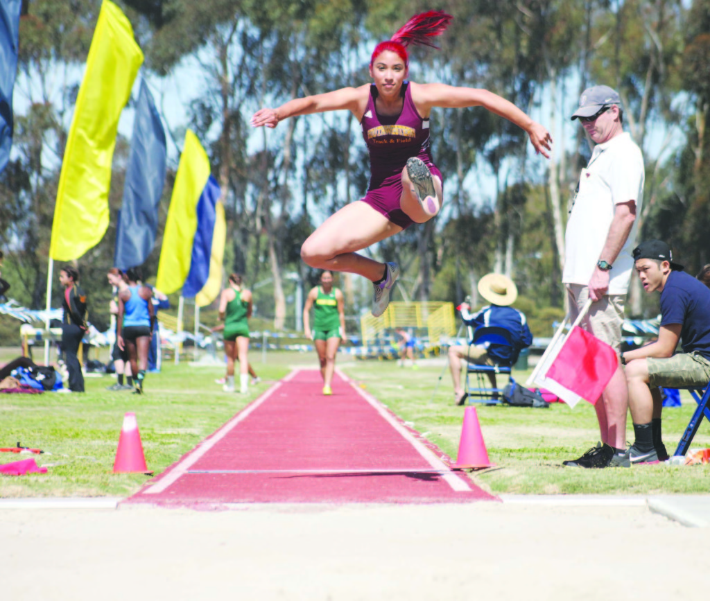 HEP CAT- Multi-talented freshman Maria De Jesus Garcia soars during the long jump, part of her seven-event heptathlon competition. She captured first place the PCAC Heptathlon Championship and also competes as a sprinter.