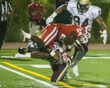 HIT AND RUN - Isaiah Young (22) tackles Jalil Shoatz (24) for a 4-yard loss. Photo by Colin Grylls