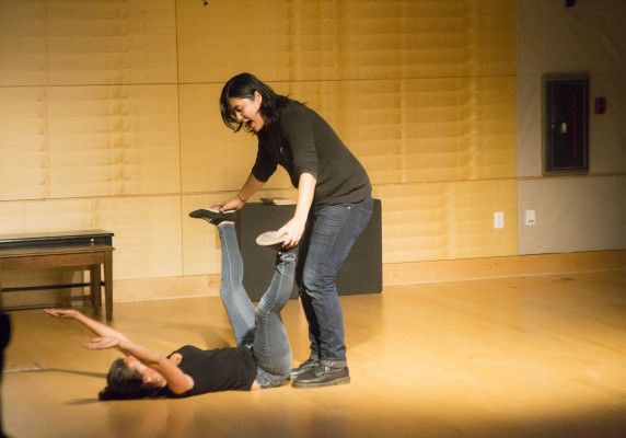 ON THE FLY — Julianne Sobjana yells Korean-gibberish into Amanda Guerrero's pelvis as the duo improvise a dance routine. Photo by Anna Pryor