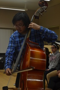 NEW, OLD MUSIC - Kyle Bayquen lays it thick on his standing bass for Musica Nova Antiqua. Photo by Alan Luna
