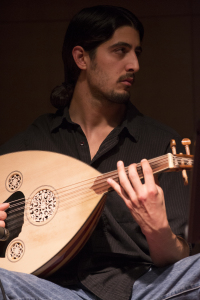 MIDDLE EASTERN DELIGHT - Louis Valenzuela jams on the oud during Dornob's performance. Dornob played its Persian fusion style of music to a packed house and featured SWC Hall of Fame alumna Stacey Barnett.  Photo by Kasey Thomas
