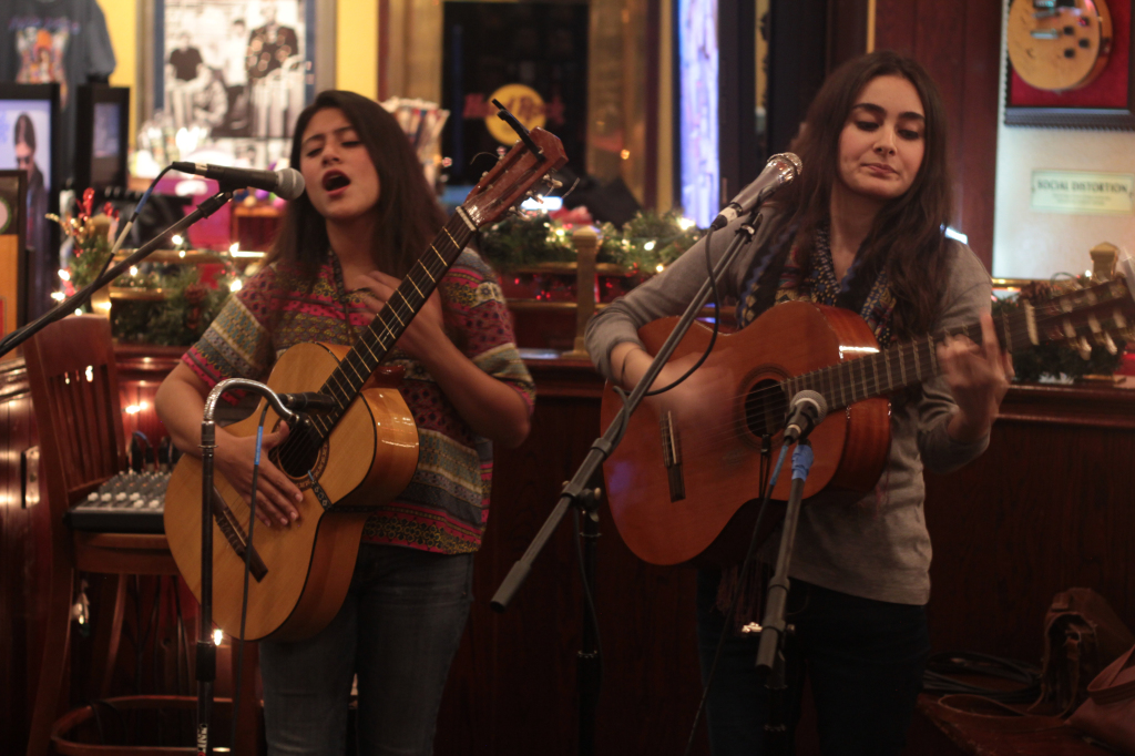 On Fifth members Fedra Ramirez (left) and Sheeran Fahrai (right) sing a sweet melody at the Hard Rock Cafe. Photo by Melvin Graham