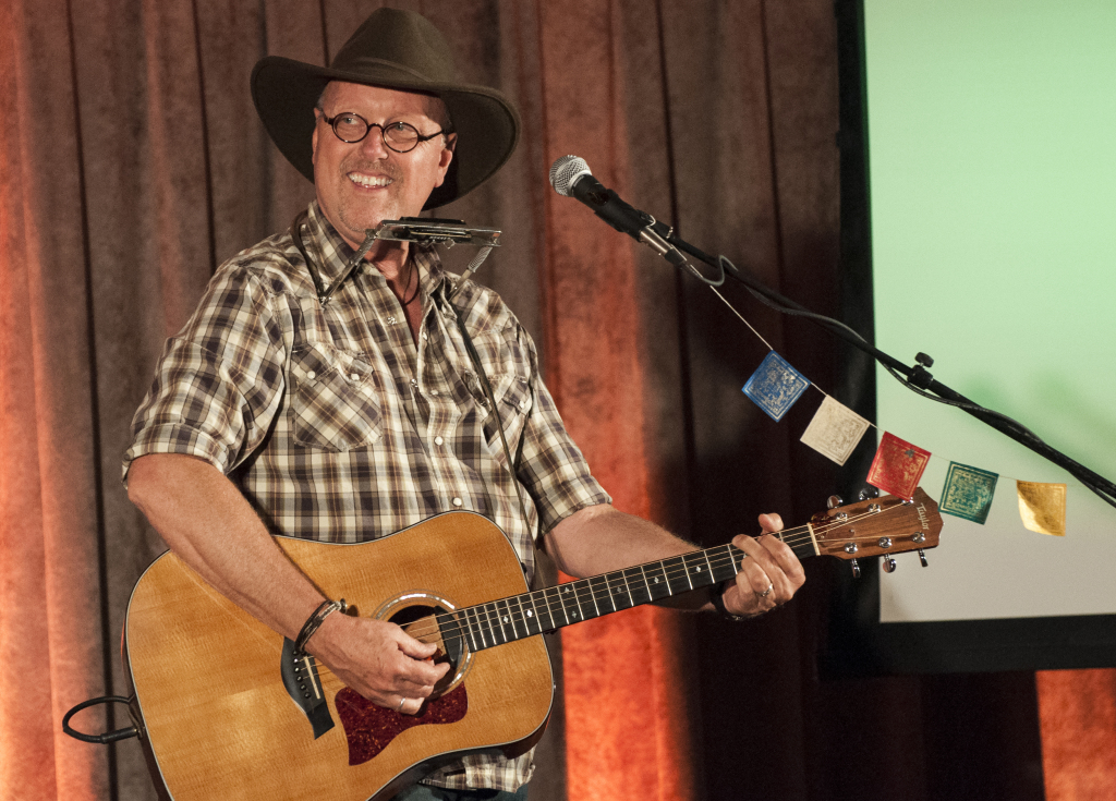 Peter Bolland captivates the crowd with the performance of an original song at a Neil Young-themed show at the Folkey Monkey, a music venue in San Diego. PHOTO BY April Abarrondo