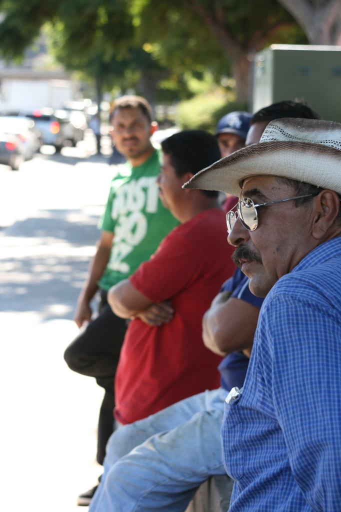 Laborers wait patiently for work under the shade of Home Depots across San Diego County.