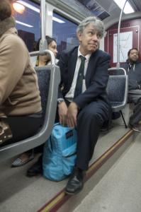 Trustee Tim Nader takes the blue line trolley down to his office.