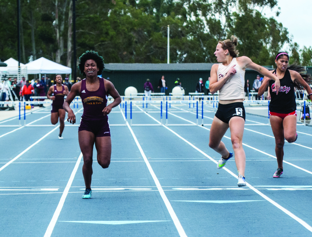 Photo Finish- Jeyla Spencer finishes just in front of Katie Baxter from De Anza College in the women's 400-meter hurdle race.