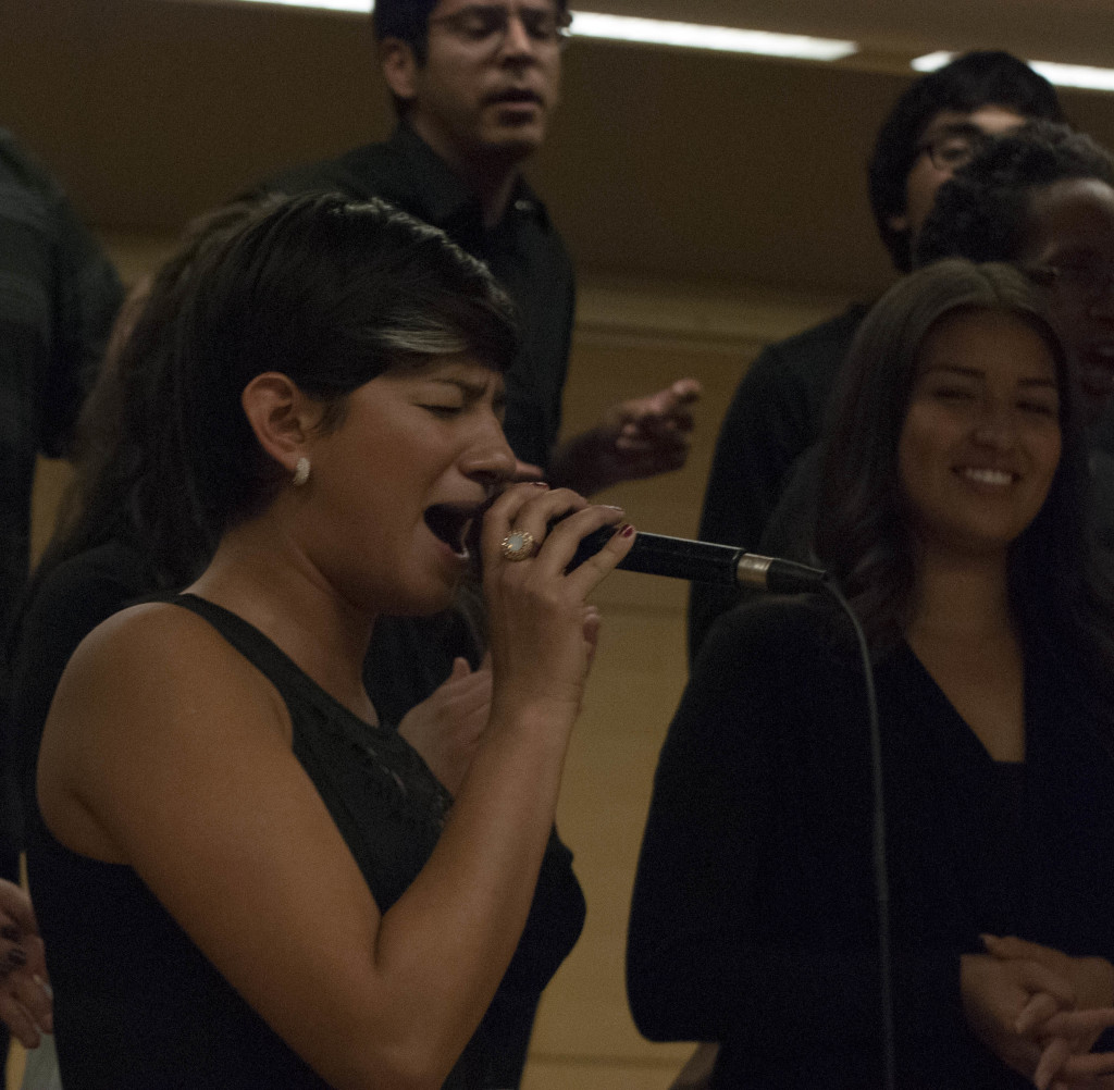 "AMAZING GRACE - Gospel Choir member Susana Gomez belts out ""As Long As I Got King jesus"" in a rousing concert in a recital hall. PHOTO BY Colin Grylls"