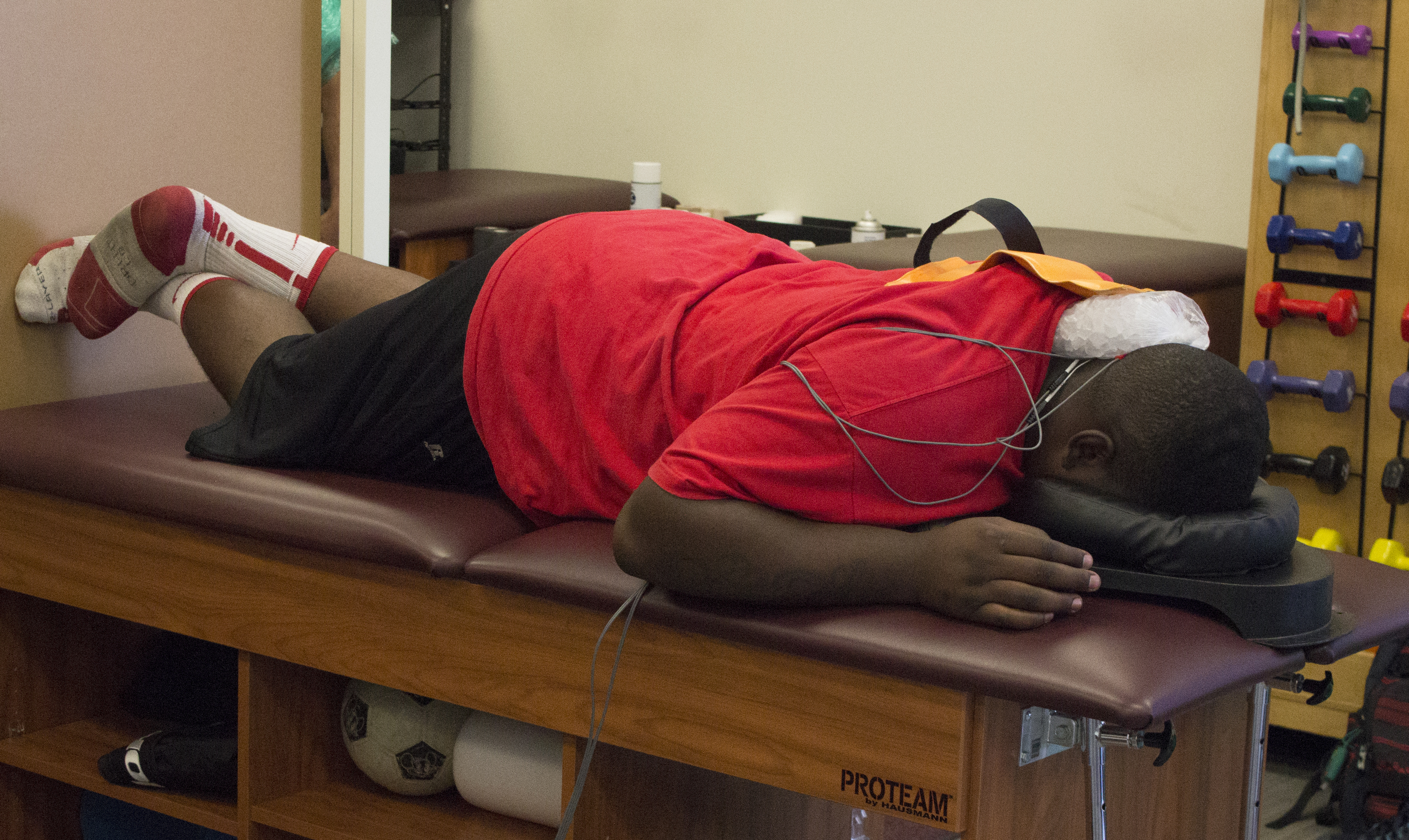 SWC junior football player gets treatment for a neck injury in the trainer's room. Photo by Mary York.