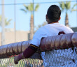 Angel Estrada, the Jaguar's second baseman, watches his friends during a down moment of a home game in March, 2016. Estrada moved to Eastlake to play baseball when he was 15 years old and his proved himself to be a good addition to Southwestern's team.