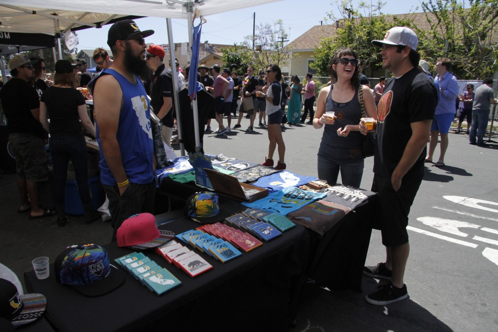 Rudy Pollorena Jr. entertains customers with his vast selection of Craft Beerd merchandise at the CityBeat Festival of Beers.