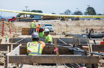 Corner Construction- Construction crew members work on the foundation for the new Wellness and  Aquatic Complex on the Southwestern College corner lot. The new center will contain three swimming  pools, exercise spaces and classrooms and is expected to be completed in 2017.