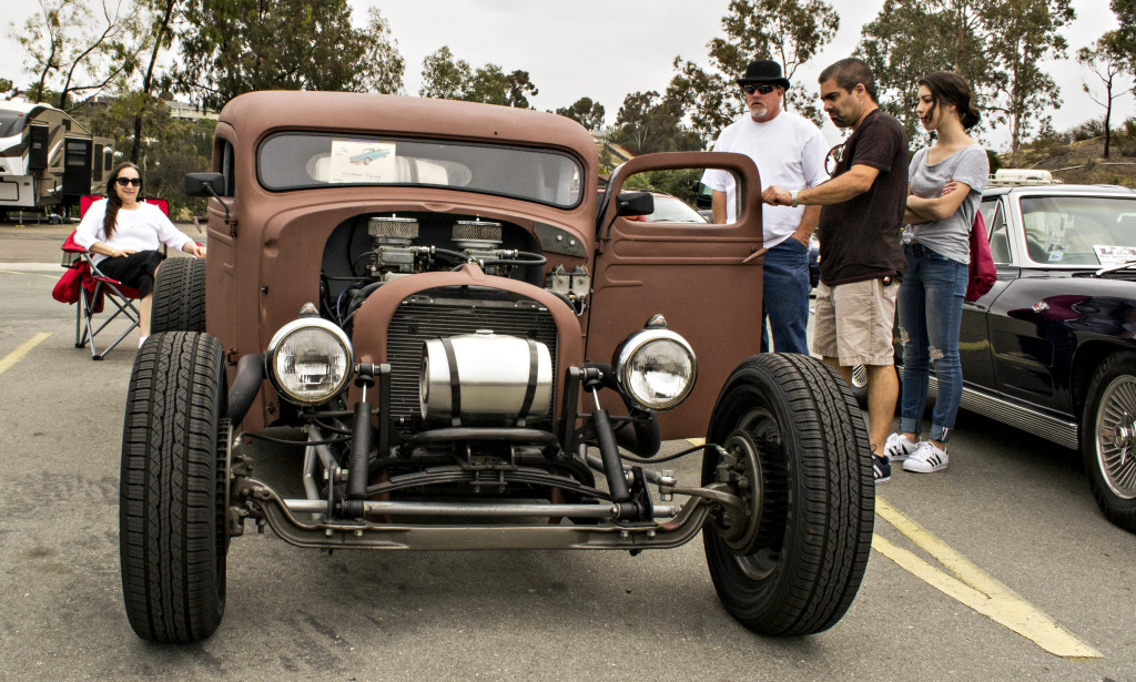 Stephen Perry shows off his 1938 chopped rat rod.