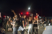 Protesters hold back traffic as they march through the streets of El Cajon. Photo by Cristofer Garcia/Staff