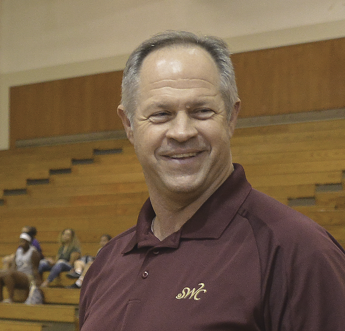 Athletic Director Jim Spillers cheers on Lady Jags at their volleyball match against SDSU's club team. Photo by William Bird
