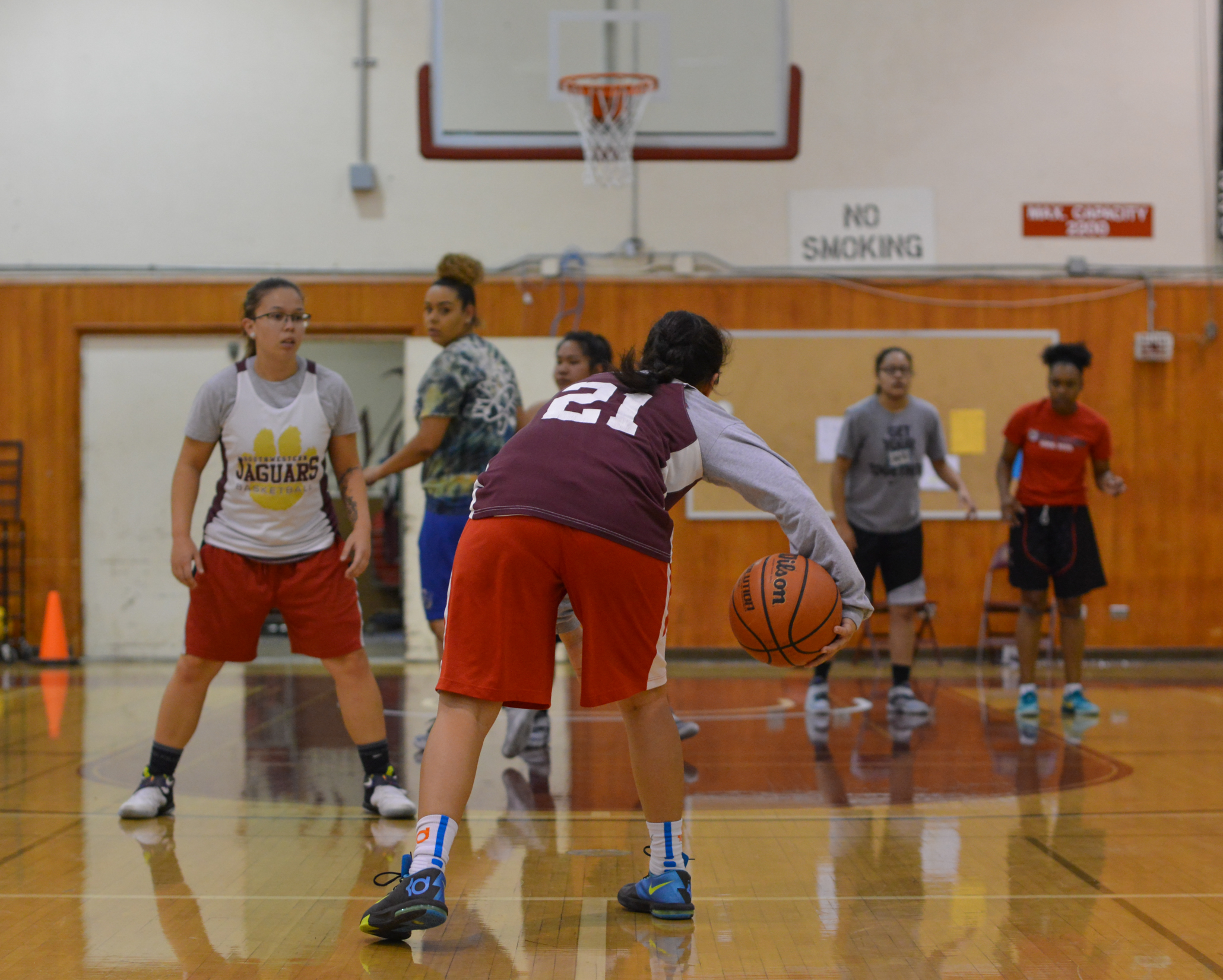 Lucky 13 — A full roster has led to more competitive practices and more wins for the Lady Jags. Last year's team had only six players. Photo by William Bird